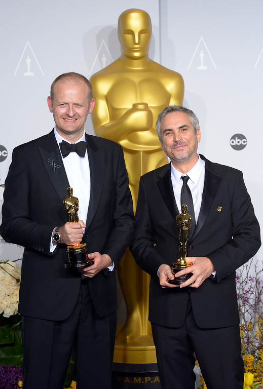 ". Alfonso Cuaron and Mark Sanger accept the Award for ""Achievement in Film Editing\"" for the film Gravity,  backstage at the 86th Academy Awards at the Dolby Theatre in Hollywood, California on Sunday March 2, 2014 (Photo by David Crane / Los Angeles Daily News)"