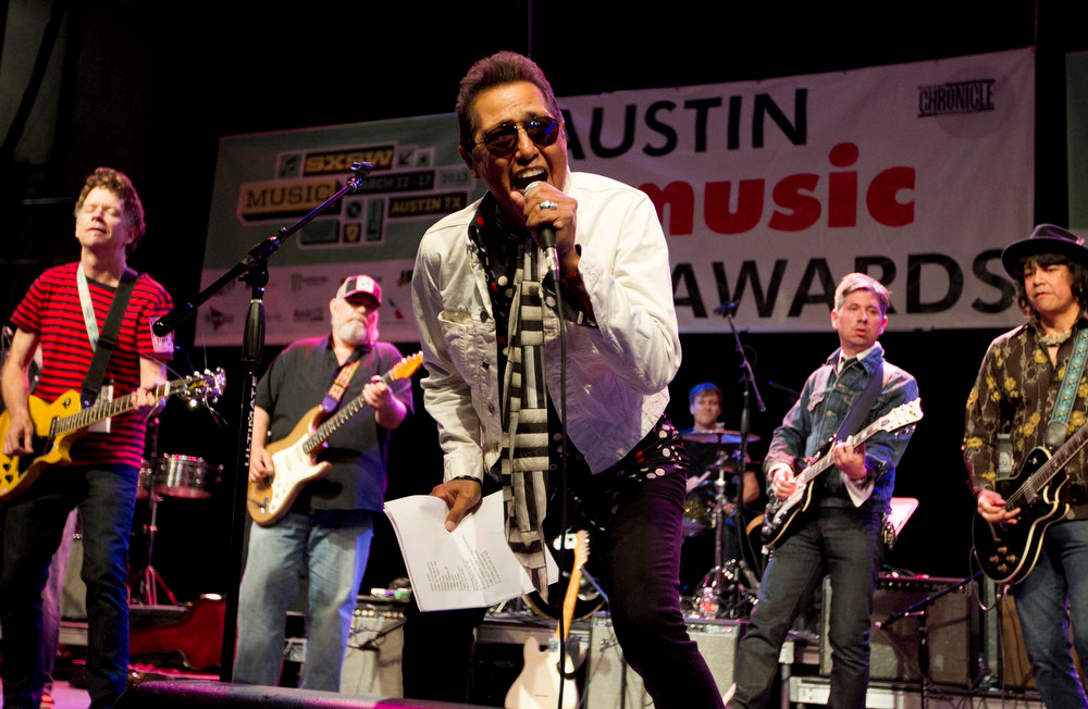. In this Wednesday, March 13, 2013 photo, Alejandro Escovedo performs at the Austin Music Awards ceremony at the Austin Music Hall in Austin, Texas. (AP Photo/Austin American-Statesman, Jay Janner)
