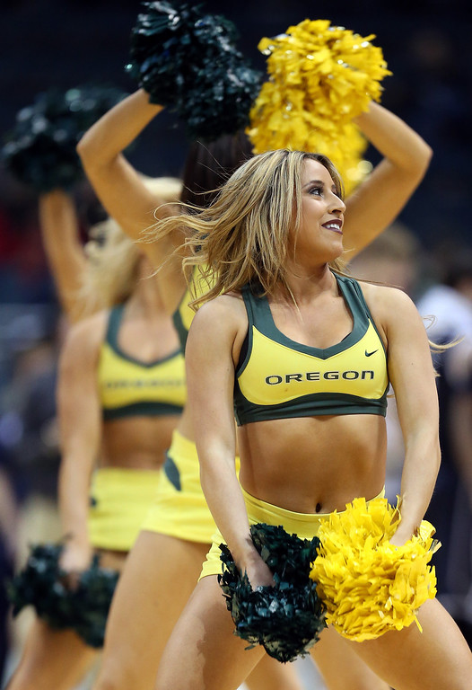 . Oregon Ducks cheerleaders perform during the second round game of the NCAA Basketball Tournament against the Brigham Young Cougars at BMO Harris Bradley Center on March 20, 2014 in Milwaukee, Wisconsin.  (Photo by Jonathan Daniel/Getty Images)