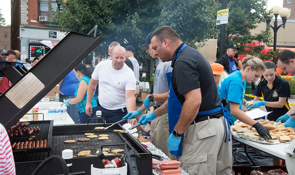 08/06/19 Wesley Bunnell | Staff The New Britain and CCSU Police held National Night out in Central Park on Tuesday evening as part of a nationwide night out designed to foster camaraderie between police and local communities. Ofc. Peter Scirpo helps fellow officers with the grilling duties.