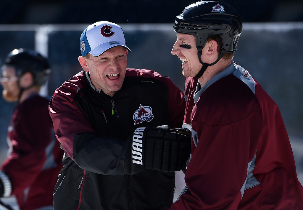 . Colorado Avalanche left wing Cody McLeod (55) shares a laugh with coach Tim Army during practice February 26, 2016 at Coors Field. (Photo By John Leyba/The Denver Post)