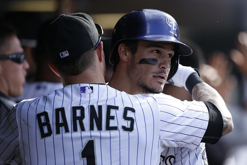 . Nolan Arenado #28 of the Colorado Rockies is congratulated in the dugout after hitting a two-run home run in the seventh inning of the game against the San Diego Padres at Coors Field on September 7, 2014 in Denver, Colorado. The Rockies won 6-0. (Photo by Joe Robbins/Getty Images)