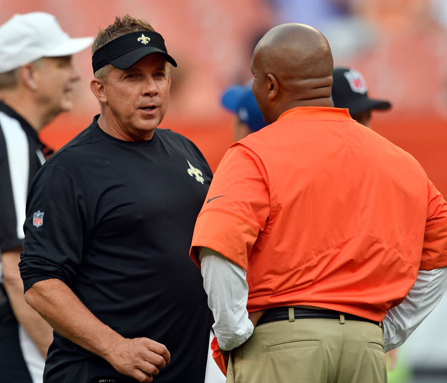. New Orleans Saints head coach Sean Payton, left, talks with Cleveland Browns head coach Hue Jackson before an NFL preseason football game, Thursday, Aug. 10, 2017, in Cleveland. (AP Photo/David Richard)
