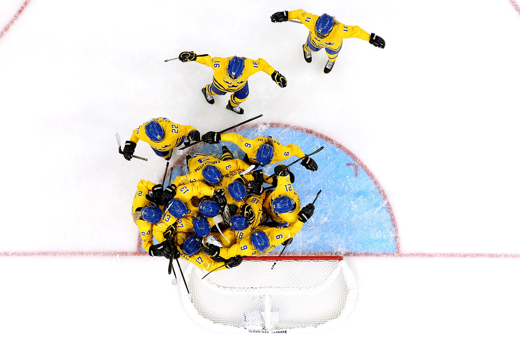 . SOCHI, RUSSIA - FEBRUARY 09:  Members of the Sweden ice hockey team celebrate their 1-0 win over Japan during the Women\'s Ice Hockey Preliminary Round Group B Game on day two of the Sochi 2014 Winter Olympics at Shayba Arena on February 9, 2014 in Sochi, Russia.  (Photo by Bruce Bennett/Getty Images)