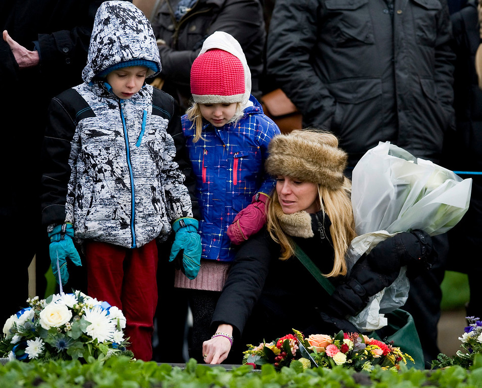 . Unidentified relatives and friends attend a memorial ceremony at Dryfesdale Cemetery in Lockerbie, Scotland, 21 December 2013. Britain marks the 25th anniversary of the Lockerbie bombing on 21 December, with memorials for the 270 victims being held in London and in the Scottish town where Pan Am flight 103 came crashing down following a terrorist attack. Pam Am flight 103 was flying from London to New York on 21 December 1988 when it exploded in the air and crashed onto Lockerbie, killing everyone on board and 11 people on the ground.  EPA/BRIAN STEWART