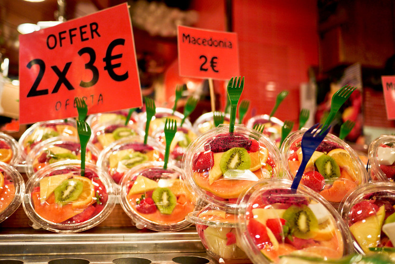 A quick snack of fresh fruit at la Boqueria market in Barcelona, Spain.