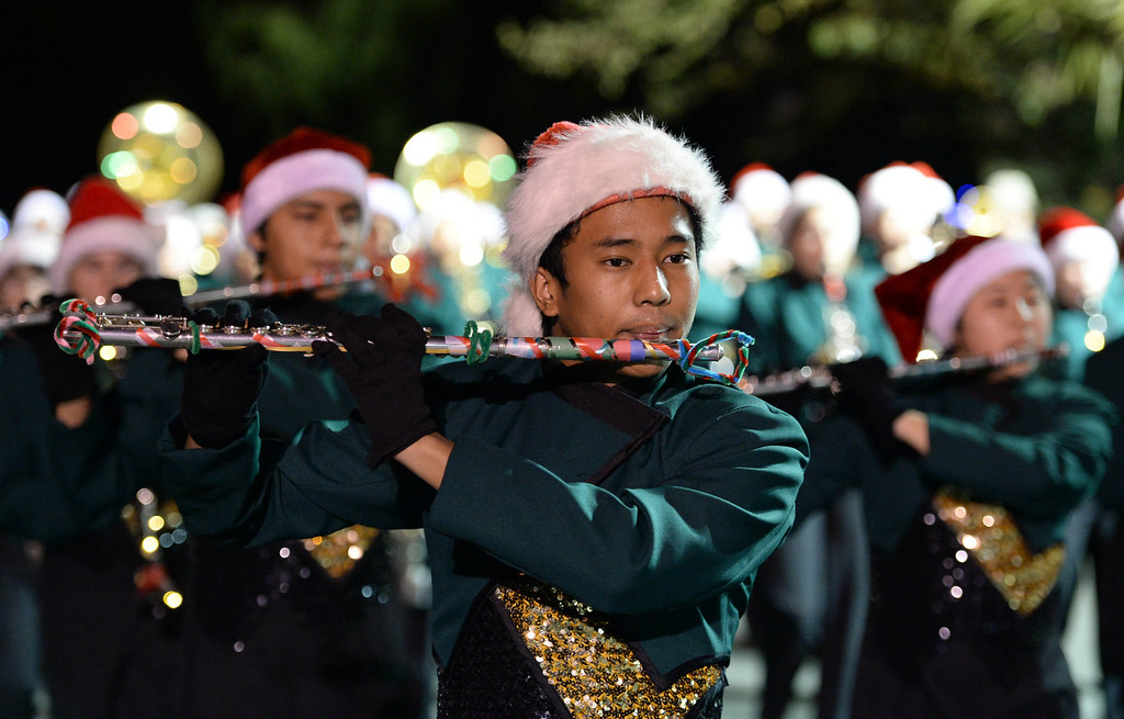 . The 60th annual Daisy Avenue Parade in the Wrigley neighborhood Saturday, December 13, 2013, in Long Beach, CA.  Long Beach Poly\'s marching band members march with instruments decked-out in Christmas lights. Photo by Steve McCrank/DailyBreeze