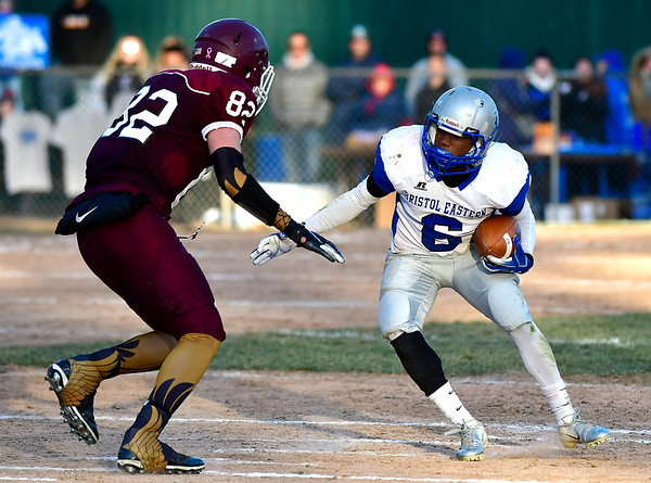 11/23/2018 Mike Orazzi   Staff Bristol Eastern's Treyvon Daniel (6) and Central's Ryan Rodriguez (82) during the Battle for the Bell at Muzzy Field Friday. Central won 24-19.