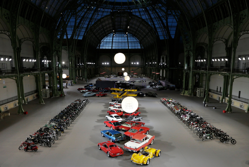 . General view of an exhibition which includes vintage cars and motorcycles at the Grand Palais exhibition hall as part of the Retromobile vintage car show in Paris February 6, 2013. This exceptional collection of motor cars and motorcycles will go on sale at a Bonhams\' auction on February 7.  REUTERS/Philippe Wojazer