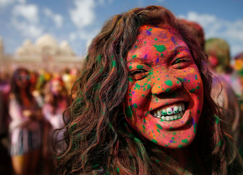 . Star Roney is covered in colored chalk during the Holi Festival of Colors at the Sri Sri Radha Krishna Temple in Spanish Fork, Utah, March 30, 2013. According to organizers 50,000 people were expected pack the temple grounds to celebrate Holi, the passing of winter to spring, and throw colorful powder throughout the day. REUTERS/Jim Urquhart