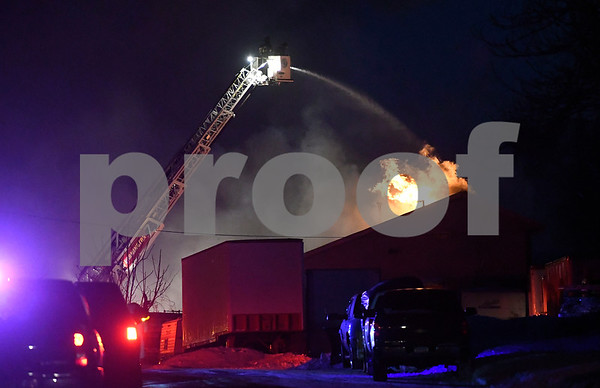 1/6/2018 Mike Orazzi | Staff Firefighters from Plainville and surrounding towns battle a fire in an industrial area on Cronk Road Saturday evening.