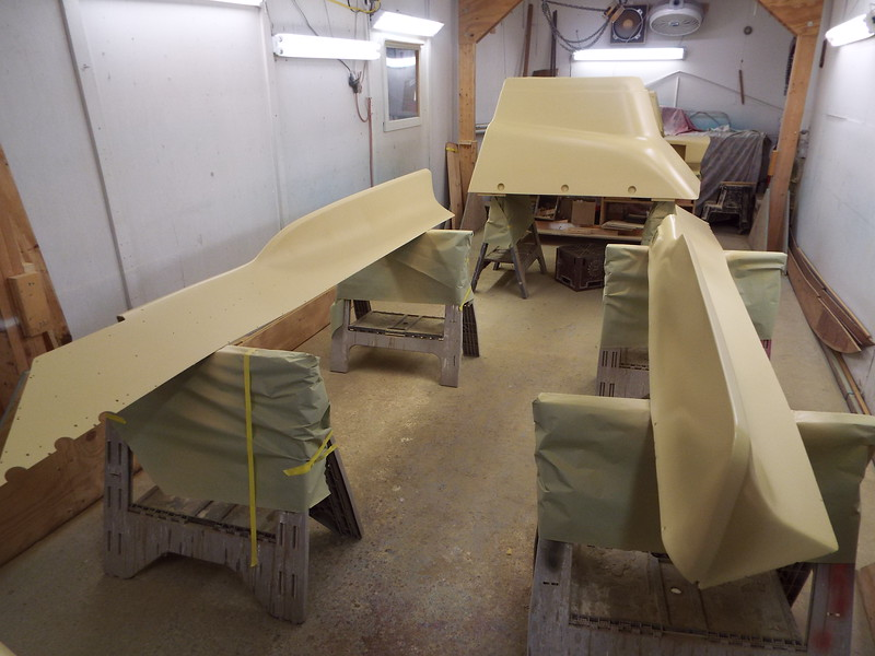 Parts with the third coat of primer applied.
