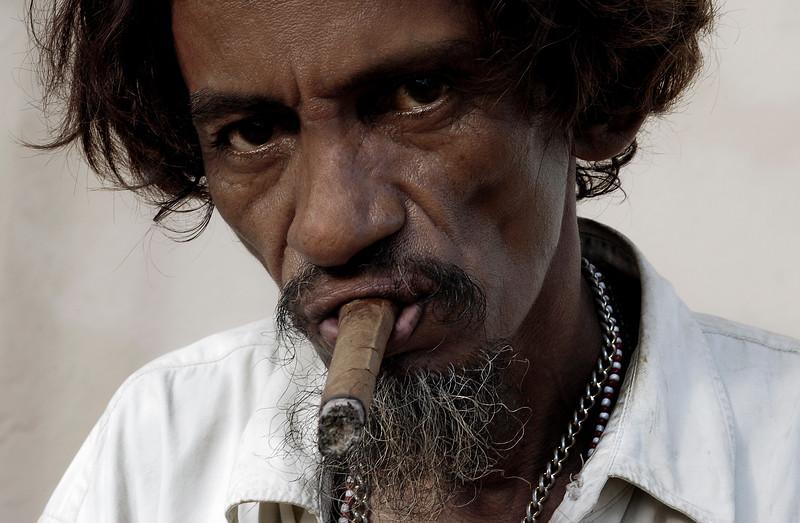 Man smoking a cuban cigar.  Trinidad, Cuba. 2006