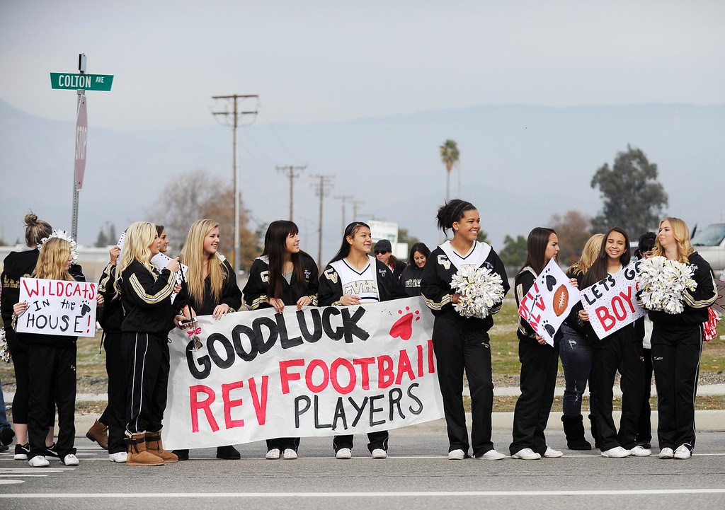 . Family and friends gather along Colton Avenue to send off the Redlands East Valley High School football team on Saturday, December 20, 2014 in Redlands, Ca. REV will compete against Clayton Valley Charter for the CIF-State Division II championship. (Photo by Micah Escamilla/Redlands Daily Facts)