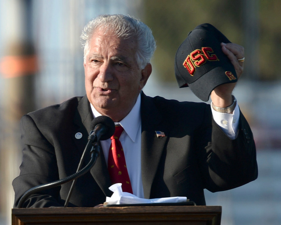 . Former Torrance Mayor Frank Scotto holds a USC hat during a memorial for Torrance legend Louis Zamperini who died earlier this month Thursday, July 31, 2014, Torrance, CA.  Zamperini was an Olympian, WWII bomber pilot and Japanese POW. A book by Laura Hildebrand titled Unbroken documented his life and a movie directed by Angelina Jolie will be released in December.  Zamperini was a runner at USC and nearly always made public appearances with a USC hat. Photo by Steve McCrank/Daily Breeze