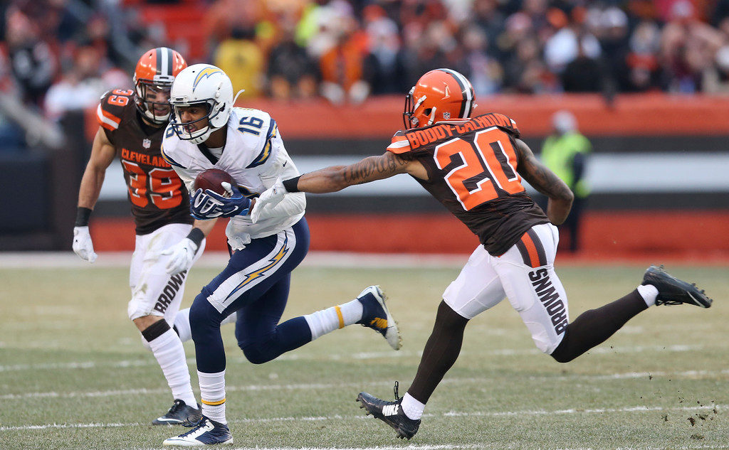 . San Diego Chargers wide receiver Tyrell Williams (16) rushes against Cleveland Browns free safety Ed Reynolds (39) and defensive back Briean Boddy-Calhoun (20) in the second half of an NFL football game, Saturday, Dec. 24, 2016, in Cleveland. (AP Photo/Aaron Josefczyk)