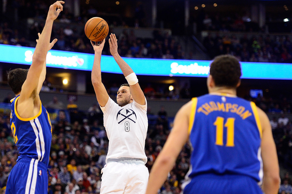 . DENVER, CO - JANUARY 13: Danilo Gallinari (8) of the Denver Nuggets shoots over Andrew Bogut (12) of the Golden State Warriors during the first half at the Pepsi Center on January 13, 2016 in Denver, Colorado.  (Photo by Brent Lewis/The Denver Post)