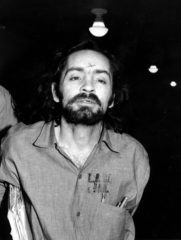 . Unsuccessful in his attempts to obtain a mistrial, Charles Manson heads for court in Los Angeles on Aug. 6, 1970 to listen to further cross-examination of the state\'s star witness, Linda Kasabian, in his trial for murder in the slayings of actress Sharon Tate and six others.  (AP Photo)