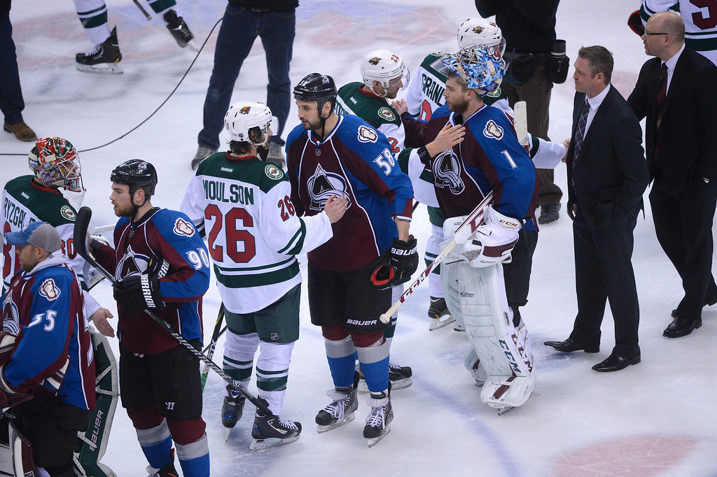 . The Minnesota Wild and Colorado Avalanche shake hands after the game. The Colorado Avalanche fell 5-4 to the Minnesota Wild in game 7 of their Stanley Cup Playoff series at the Pepsi Center in Denver, Colorado on Wednesday, April 30, 2014. (Photo by Karl Gehring/The Denver Post)