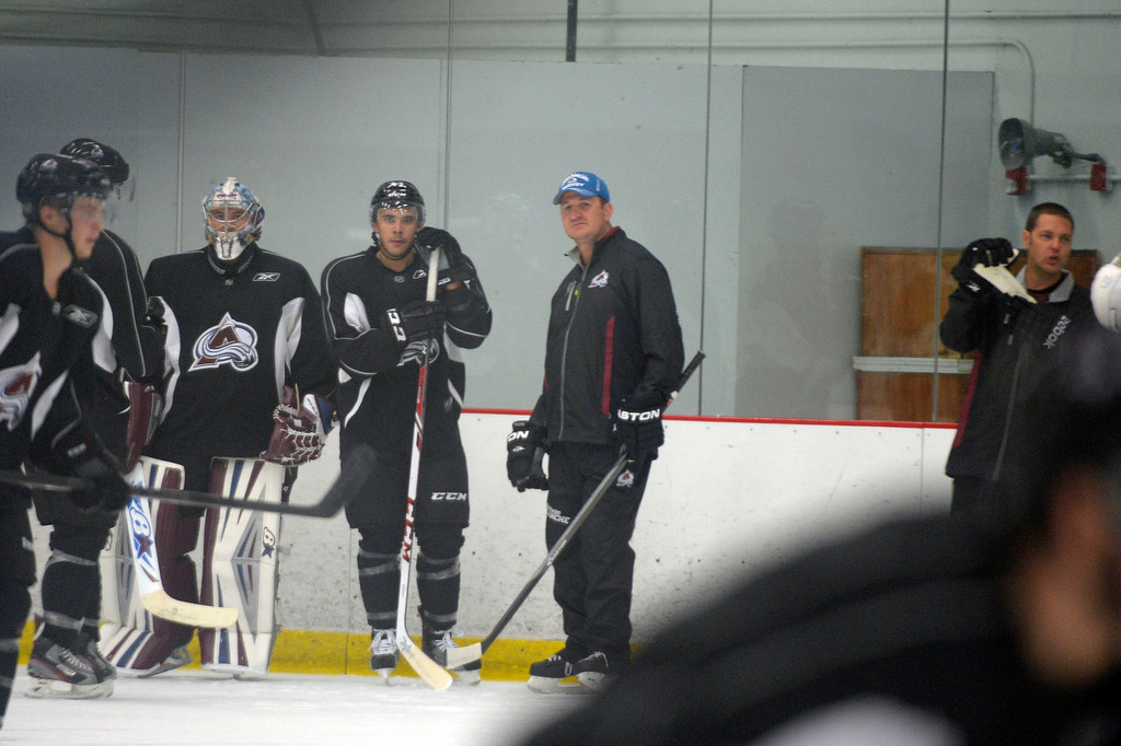 . Colorado Avalanche Adam Foote helps out the rookies on the second day at rookie Camp practice September 9, 2013 at Family Sports Ice Arena. (Photo By John Leyba/The Denver Post)