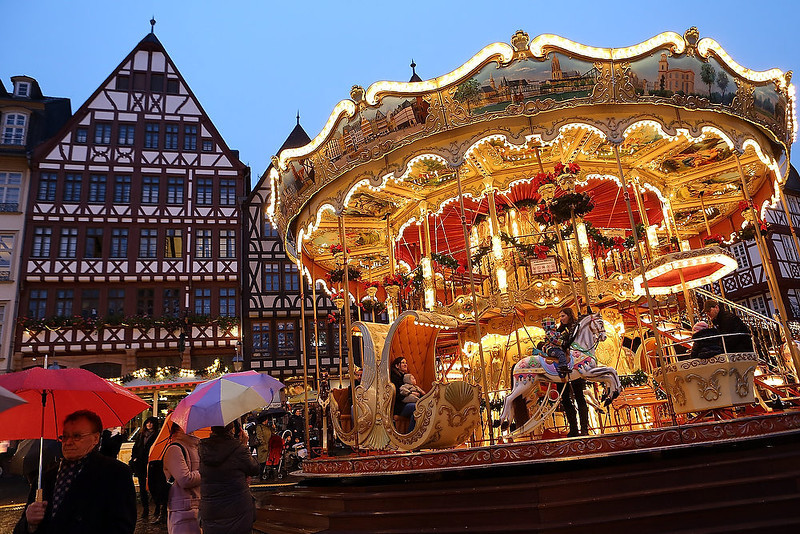 . People ride a carousel at the annual Christmas market in the city center on its opening day on November 26, 2012 in Frankfurt, Germany. Christmas markets, with their stalls selling mulled wine, Christmas tree decorations and other delights, are an integral part of German Christmas tradition, and many of them opened across Germany today. (Photo by Hannelore Foerster/Getty Images)