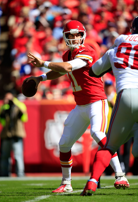 . KANSAS CITY, MO - SEPTEMBER 29:  Quarterback Alex Smith #11 of the Kansas City Chiefs looks to pass during the game against the New York Giants at Arrowhead Stadium on September 29, 2013 in Kansas City, Missouri.  (Photo by Jamie Squire/Getty Images)