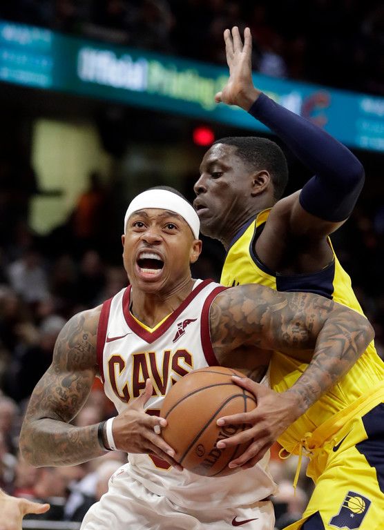 . Cleveland Cavaliers\' Isaiah Thomas, left, drives past Indiana Pacers\' Darren Collison during the first half of an NBA basketball game, Friday, Jan. 26, 2018, in Cleveland. (AP Photo/Tony Dejak)
