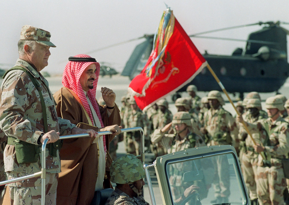 Description of . King Fahd, second left, rides with U.S. Gen. Norman Schwarzkopf as they review U.S. troops at an airbase in eastern Saudi Arabia on Jan. 7, 1991. Fahd, who moved his country closer to the United States but ruled the world's largest oil producing nation in name only since suffering a stroke in 1995, died early Monday, Aug. 1, 2005 the Saudi royal court said. He was said to be 84. (AP Photo/Bob Daugherty)