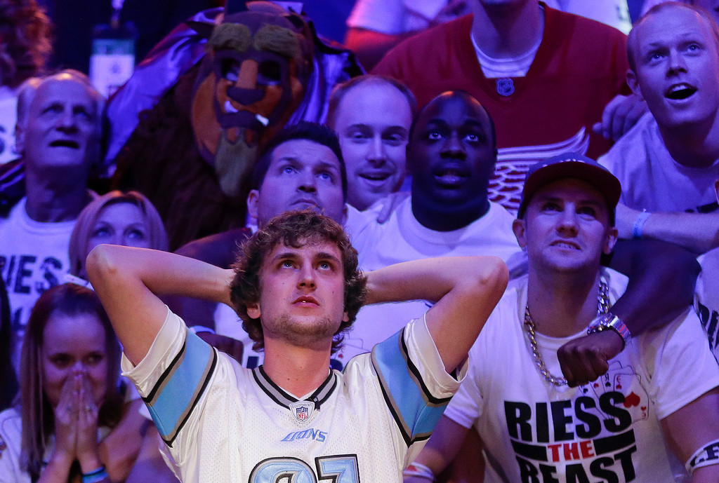 . Ryan Riess watches the flop with supporters after an all-in call by Jay Farber during the World Series of Poker final table, Tuesday, Nov. 5, 2013, in Las Vegas. Farber won the hand to stay alive in the event. (AP Photo/Julie Jacobson)