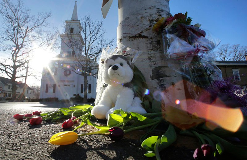 . Flowers and stuffed animals of a makeshift memorial for school shooting victims encircle the flagpole at the town center in Newtown, Conn., Saturday, Dec. 15, 2012.  The massacre of 26 children and adults at Sandy Hook Elementary school elicited horror and soul-searching around the world even as it raised more basic questions about why the gunman, 20-year-old Adam Lanza, would have been driven to such a crime and how he chose his victims. (AP Photo/Charles Krupa)