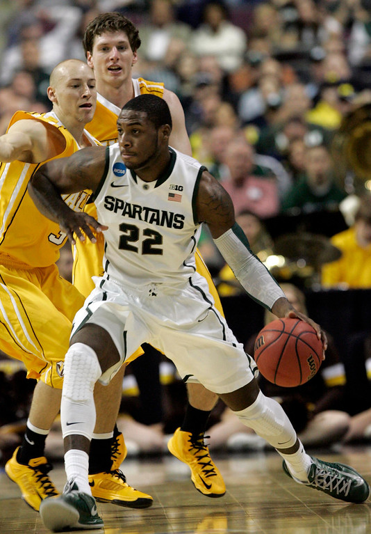 . Michigan State guard Branden Dawson (C) carries the ball down court in front of the Valparaiso defense during the first half of their second round NCAA tournament basketball game in Auburn Hills, Michigan March 21, 2013.  REUTERS/ Rebecca Cook