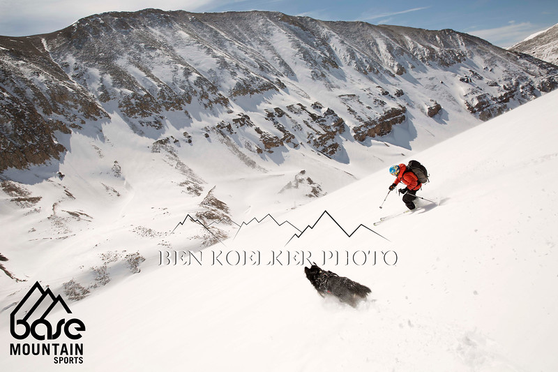 Joel Paula being chased by his dog Max while skiing Mount Dyer in the Tenmile Range, CO