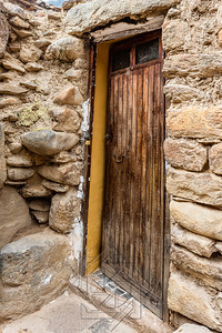 Old wooden door built into a ancient stone wall