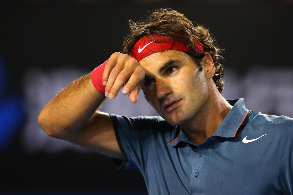 . Roger Federer of Switzerland wipes his face in his semifinal match against Rafael Nadal of Spain during day 12 of the 2014 Australian Open at Melbourne Park on January 24, 2014 in Melbourne, Australia.  (Photo by Mark Kolbe/Getty Images)