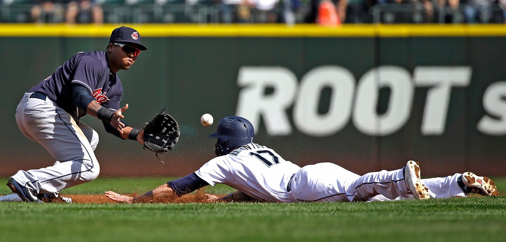 . Seattle Mariners\' Mitch Haniger (17) slides in safely as Cleveland Indians second baseman Jose Ramirez waits for the ball in the first inning of a baseball game Saturday, Sept. 23, 2017, in Seattle. (AP Photo/Elaine Thompson)