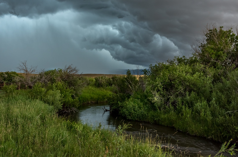 Storm clouds over the Muscleshell River near Martinsdale, Montana