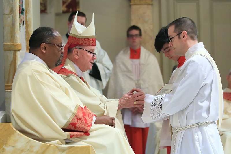 Bishop Malooly and Richard Jasper join hands during his Ordination at Cathedral of Saint Peter Church, Saturday, May 20, 2017. wwwDonBlakePhotography.com