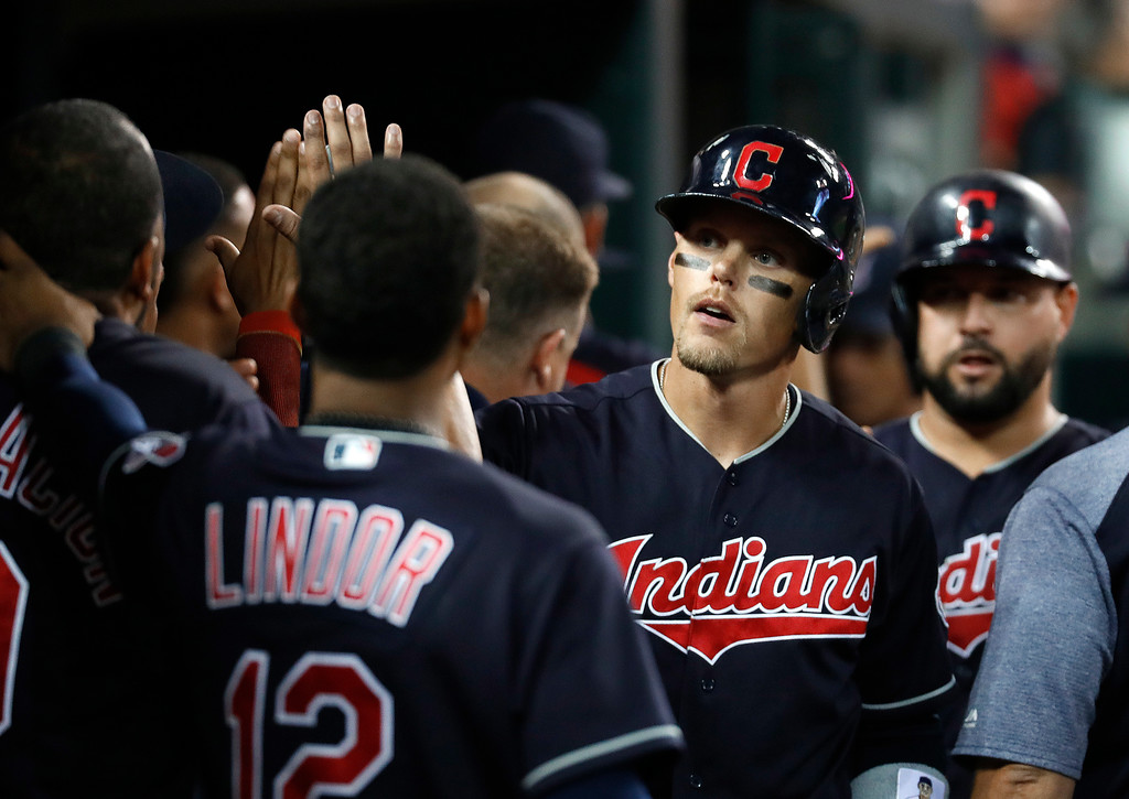 . Cleveland Indians\' Brandon Guyer celebrates his three-run home run against the Detroit Tigers in the eighth inning of a baseball game in Detroit, Friday, July 27, 2018. (AP Photo/Paul Sancya)