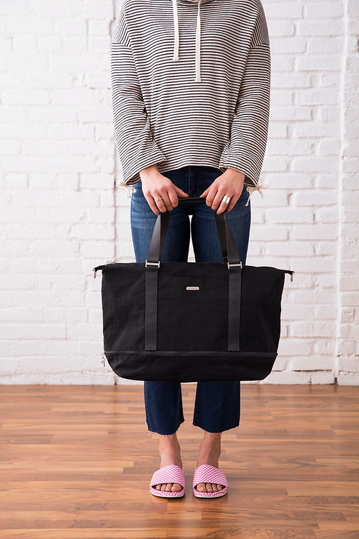 Photo of a black expandable carry on duffle bag expanded.