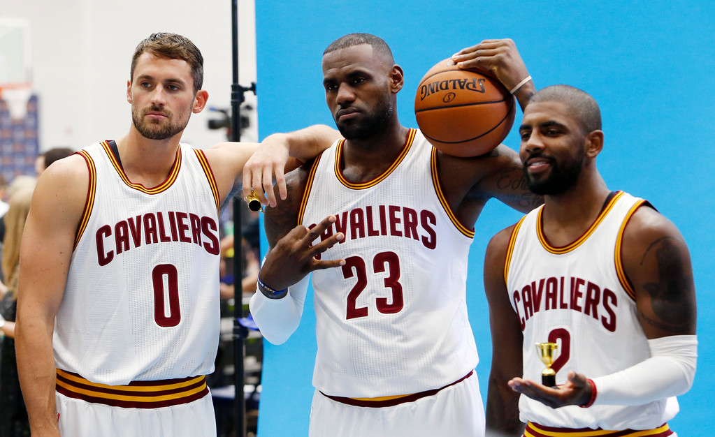 . Cleveland Cavaliers forward Kevin Love (0), LeBron James (23) and Kyrie Irving (2) pose for photographs during the NBA basketball team\'s media day, Monday, Sept. 26, 2016, in Independence, Ohio. (AP Photo/Ron Schwane)
