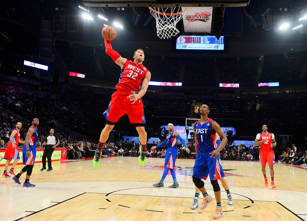 . NBA All-Star Blake Griffin of the Los Angeles Clippers (32) attempts to dunk past All-Star Chris Bosh of the Miami Heat (1) during the 2013 NBA All-Star basketball game in Houston, Texas, February 17, 2013. REUTERS/Bob Donnan-POOL (UNITED STATES  - Tags: SPORT BASKETBALL)