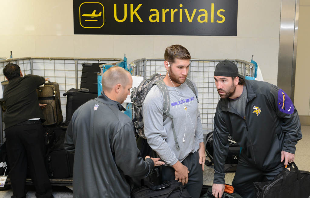 . Minnesota Vikings Jared Allen, right, collects luggage after arrival at Gatwick Tuesday. (Photo: Dave Shopland)