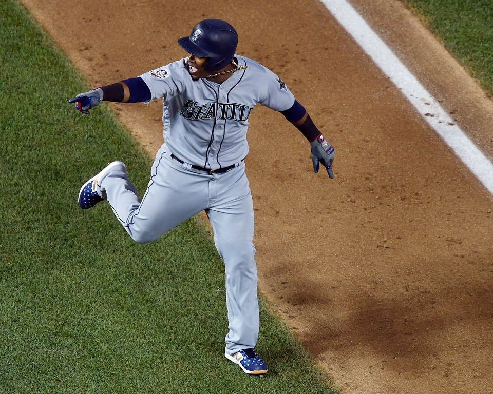 . Seattle Mariners Jean Segura (2) points the bench as he rounds the bases on a three-run homer in the eighth inning during the Major League Baseball All-star Game, Tuesday, July 17, 2018 in Washington. (AP Photo/Susan Walsh)