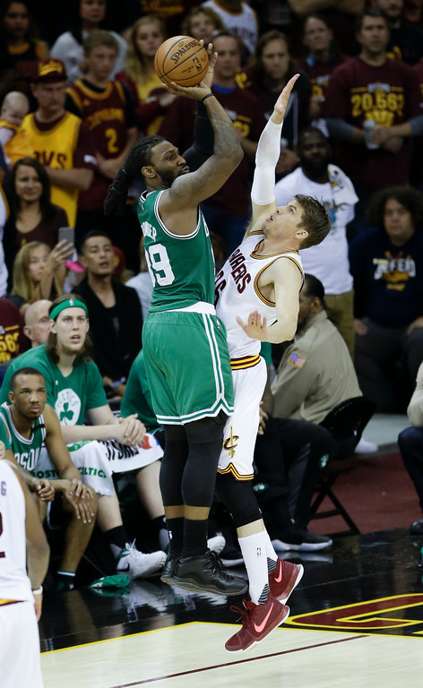 . Boston Celtics\' Jae Crowder (99) shoots over Cleveland Cavaliers\' Kyle Korver (26) during the second half of Game 4 of the NBA basketball Eastern Conference finals, Tuesday, May 23, 2017, in Cleveland. (AP Photo/Tony Dejak)