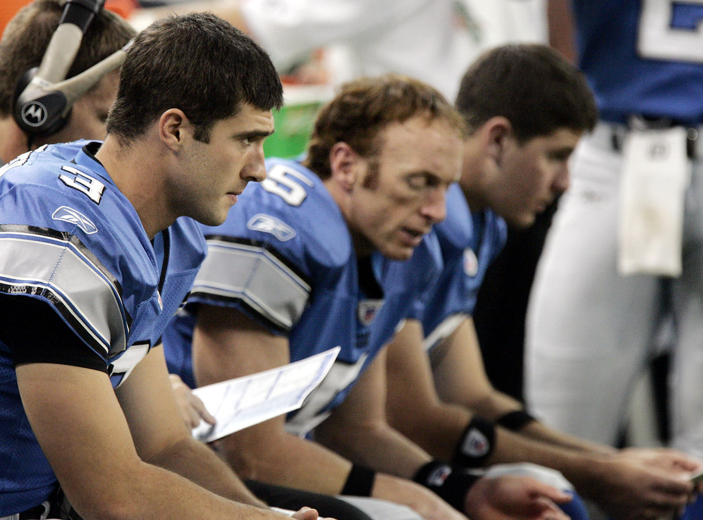 . DETROIT LIONS - Detroit Lions quarterbacks, from left, Joey Harrington, Jeff Garcia and Dan Orlovsky sit on the bench during a break in their game against the Chicago Bears on Oct. 30, 2005, at Ford Field in Detroit. With a .500 record through six games, the Lions\' were atop the lowly NFC North with Chicago, and their preseason bravado wasn\'t thrown in their faces. Two losses later, they looked like the same old Lions. (AP Photo/Carlos Osorio)