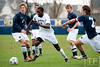 Nov 13, 2011; Ann Arbor, MI, USA; Northwestern Wildcats forward Oliver Kupe (8) gets through the Penn State Nittany Lions defense in the second half at the final game of the 2011 Big Ten Championship at Michigan Soccer Stadium. Wildcats won 2-1. Mandatory Credit: Tim Fuller-US PRESSWIRE