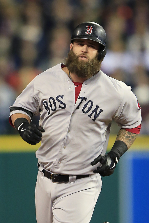 . Mike Napoli #12 of the Boston Red Sox runs the bases on his second inning solo homerun against the Detroit Tigers during Game Five of the American League Championship Series at Comerica Park on October 17, 2013 in Detroit, Michigan.  (Photo by Jamie Squire/Getty Images)
