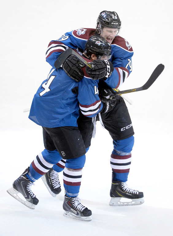 . Tyson Barrie (4) was congratulated by teammate Nathan MacKinnon (29) after the game winning goal Thursday.  The Colorado Avalanche defeated the Vancouver Canucks 3-2 in overtime Thursday night, March 27, 2014 at the Pepsi Center in Denver, Colorado. (Photo by Karl Gehring/The Denver Post)