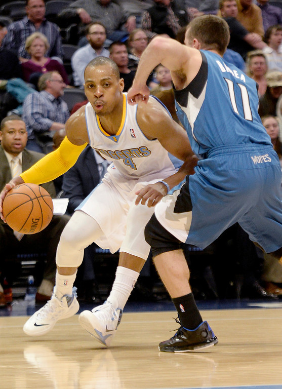 . Randy Foye (4) of the Denver Nuggets drives on J.J. Barea (11) of the Minnesota Timberwolves during the second quarter at the Pepsi Center.   (Photo By AAron Ontiveroz/The Denver Post)