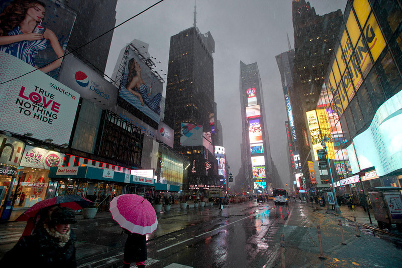 . Pedestrians walk through Times Square as snow falls Friday, Feb. 8, 2013, in New York. A blizzard of potentially historic proportions threatens to strike the Northeast with 1 to 2 feet of snow forecast along the densely populated Interstate 95 corridor from New York City to Boston and beyond. (AP Photo/Frank Franklin II)